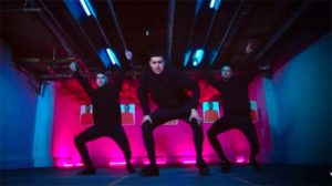 Fire dance team members (from the left) Andretty Lucatero, Eric Payan and Paul Lopez perform in the music video of