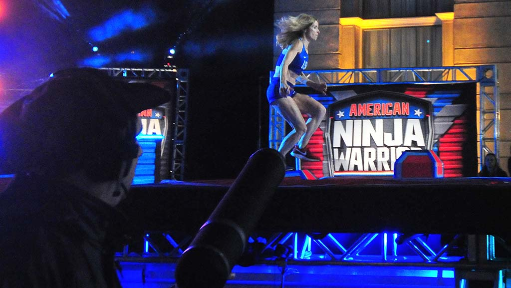 """With a directional microphone following her, Colleen Barney takes the first of the Shrinking Steps at """"American Ninja Warrior."""""""