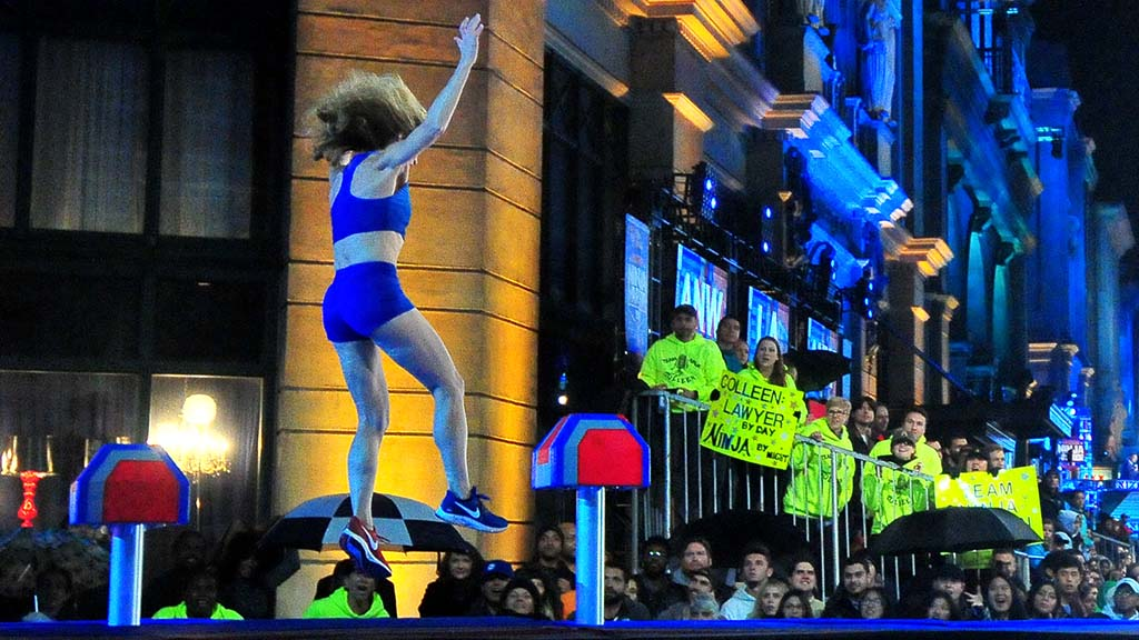 """Colleen Barney opts against a """"wipeout"""" try for the final step and allows herself to drop into the unheated pool at """"American Ninja Warriors."""""""
