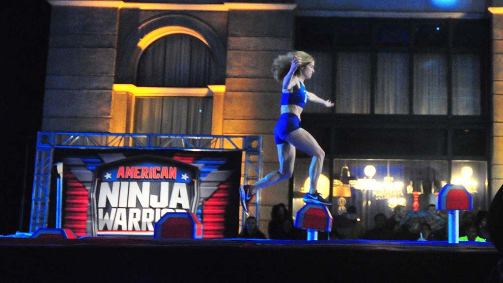"""With the third Shrinking Step tilting underfoot, Colleen Barney prepares to move to the fourth step on """"American Ninja Warrior."""""""