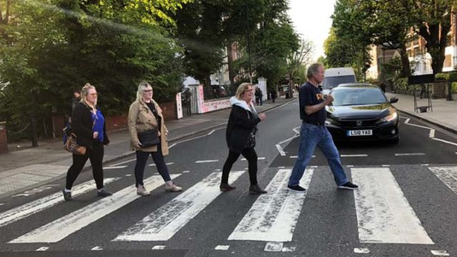 "Replicating the Beatles' ""Abbey Road"" album cover were (from left) daughters Michaela and Chantal, mother Leslie and father Max Branscomb. Max used a credit card to finance the trip to see his soon-to-graduate UC Irvine theater arts major daughter Chantal and didn't draw from his GoFundMe account, which all went to medical expenses."