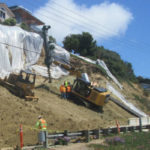 Crews build retaining wall