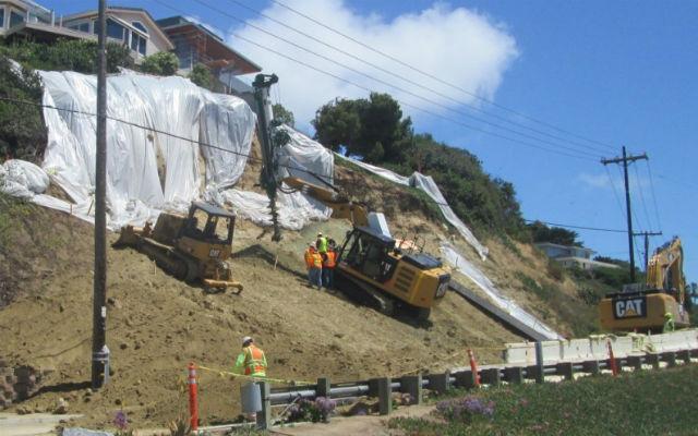 Crews build retaining wall