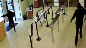 One masked gunmen is seen in takeover-style robbery of SDCCU branch in Escondido.