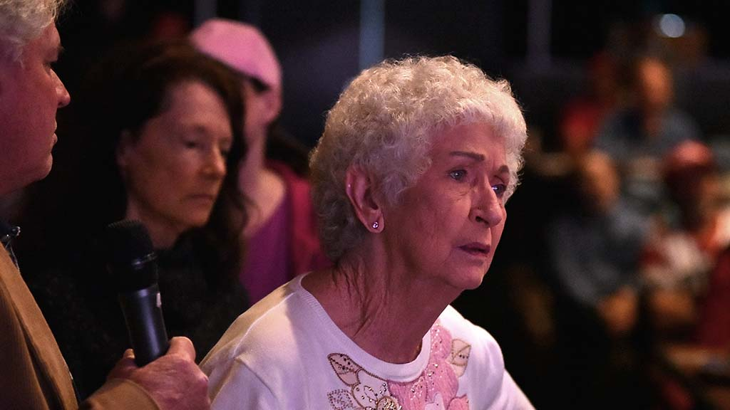 La-Faye Zeigler of Ramona listens to Rep. Duncan D. Hunter explain why Interstate 5 checkpoint is closed — because of deployment of agents to the border.