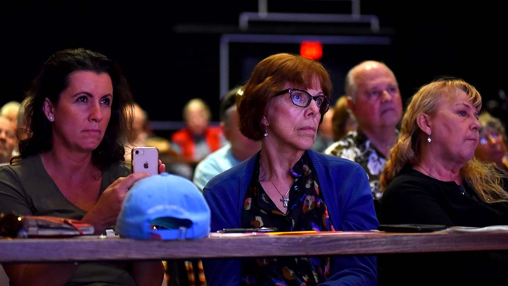 Audience members listen to border-security forum featuring comments by Rep. Duncan D. Hunter and his congressman father.
