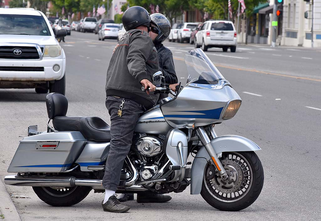 A couple kiss on Ramona's Main Street before they hopped on bike to join a small motorcycle caravan.