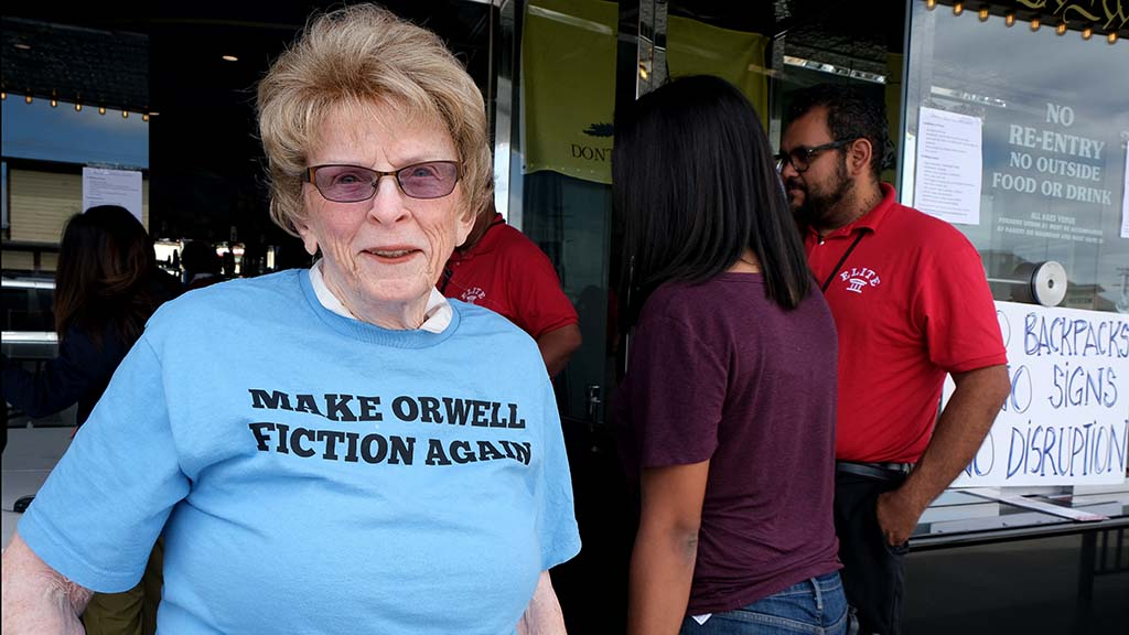 "A woman who gave only her last name — Riddle — wears a ""Make Orwell Fiction Again"" T-shirt at Ramona event."