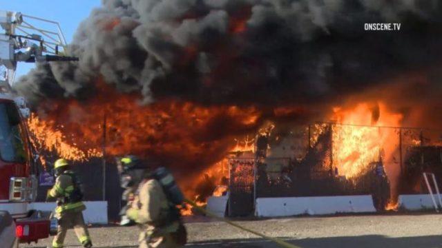 Firefighters at junkyard fire