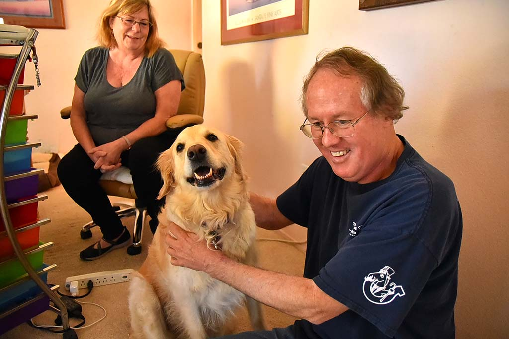Leslie and Max Branscomb at home with their golden retriever Leliani