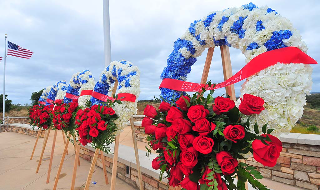 Wreaths in honor of the four branches of the military decorated the Memorial Day event at Miramar National Cemetery Sunday.
