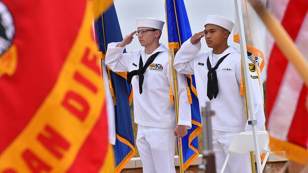 Members of he Sea Cadets salute during the National Anthem at the Miramar National Cemetery's Memorial Day observation.