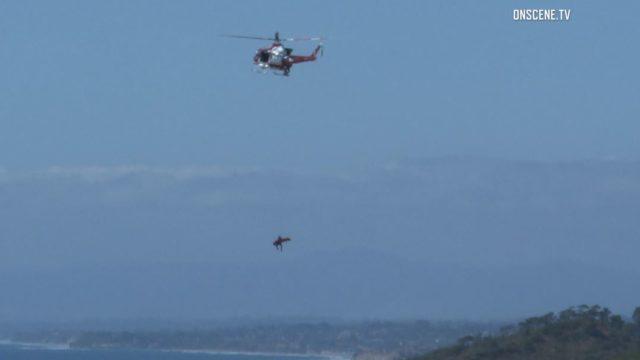 Helicopter hoists injured paraglider pilot