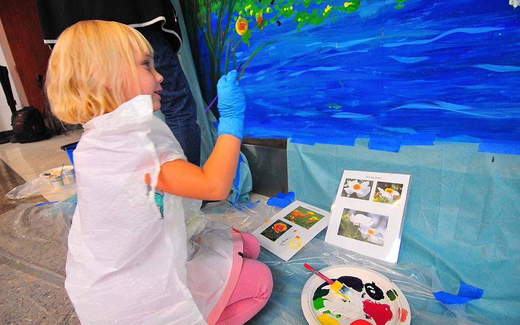 "Alexis Fulton, 5, of El Centro declared, ""I love to paint"" and contributed flowers and birds to the art project."