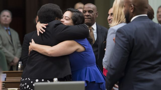Shirley Weber hugged after her bill passes