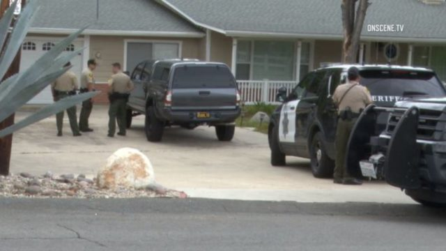Sheriff's deputies outside home in Spring Valley