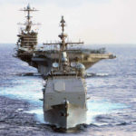 USS Mobile Bay leads the USS John Stennis