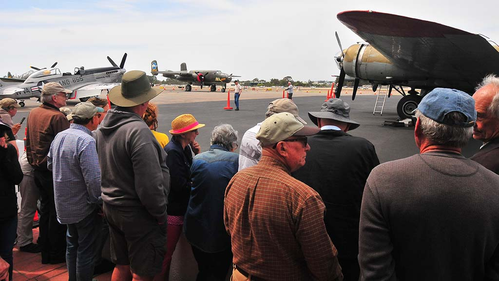 About 100 gathered to get a close-up look at five World-War II-era airplanes on display at McClellan-Palomar Airport in Carlsbad.