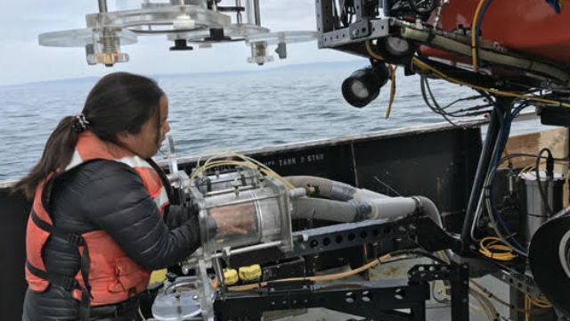 Anela Choy aboard a research vessel in Monterey Bay