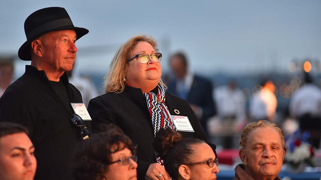 Family of deceased Battle of the Midway veteran Vice Adm. David C. Richardson watch the tribute for their family's loved one.