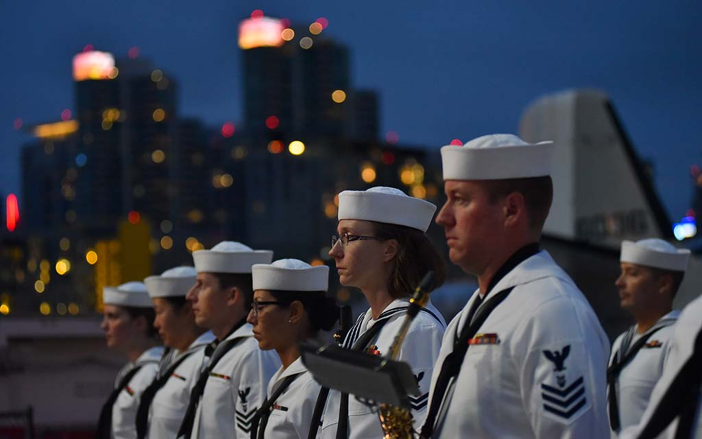 Members of the Navy Band Southwest stand at attention during the playing of Taps.