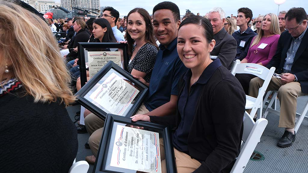 Enlistees (left to right) Emerson Albright, M. Lee Dixon and Paige Dominguez received certificates of enlistment aboard the USS Midway.