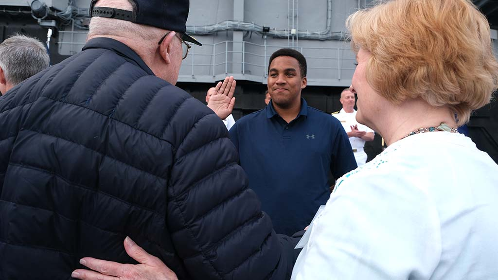 "Enlistee M. Lee Dixon of San Diego (center) takes his oath in front of Battle of Midway veteran Truxton ""T.K."" Ford in a passing of the torch ceremony."