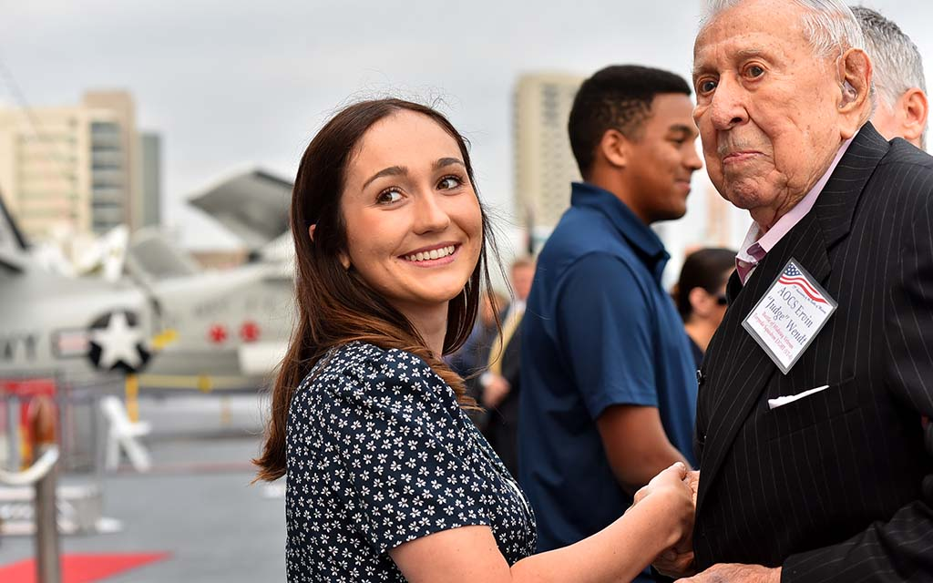 "Emerson Albright of San Diego, a new Navy enlistee, poses with Battle of Midway veteran Ervin ""Judge"" Wendt during a passing of the torch anniversary ceremony."