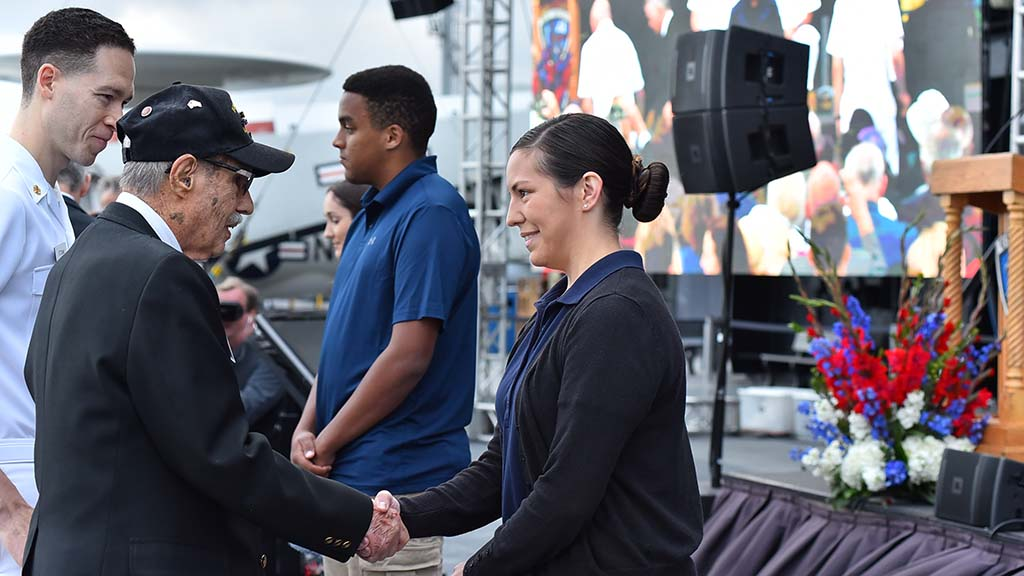 Enlistees M. Lee Dixon (center) and Paige Dominguez had their swearing in ceremony on the USS Midway as part of the Battle of the Midway anniversary ceremony.