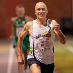 Brad Barton of Spanish Fork, Utah, sprints toward finish line of his 4:19.59 mile world record in the 50-54 age group at Nashville.