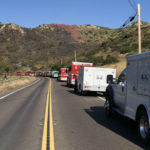 Cal Fire vehicles at the scene of a brush fire
