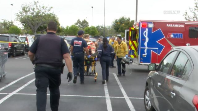 Costco victim is wheeled to an ambulance