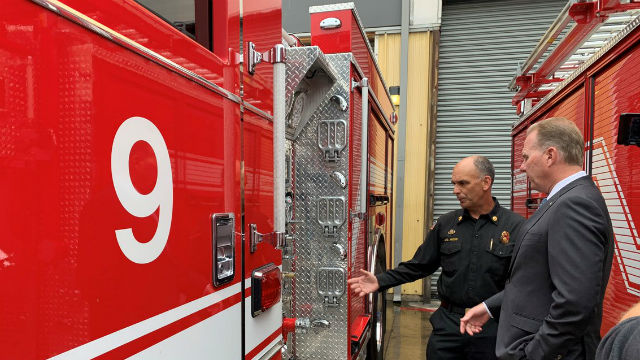 Mayor Kevin Faulconer inspects a new fire engine