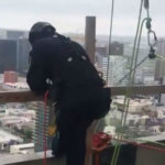 San Diego Fire-Rescue personnel atop the high rise