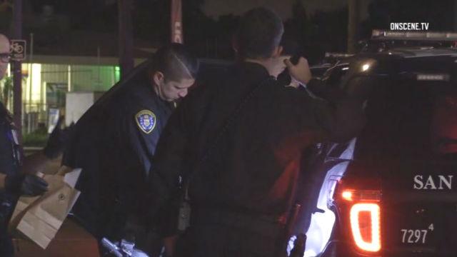 San Deigo Police escort suspect into police cruiser