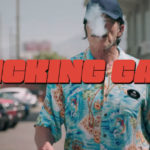 "Arnold Schwarzenegger in scene from ""Kicking Gas"""