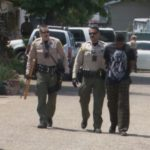 Deputies escort a suspect in the Lemon Grove assault