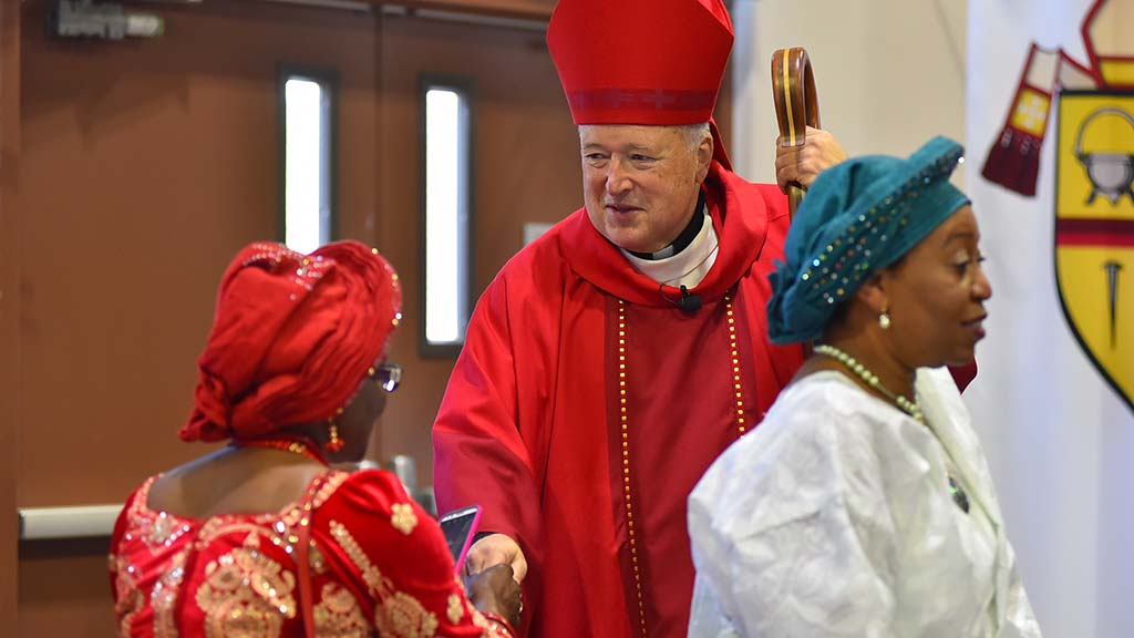San Diego Bishop Robert McElroy greets members of the African American Catholic Community.