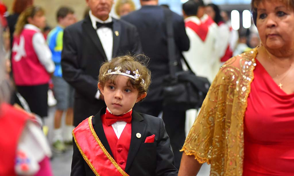 A young boy representing the Italian Catholic community participates in the multicultural Mass in Del Mar.