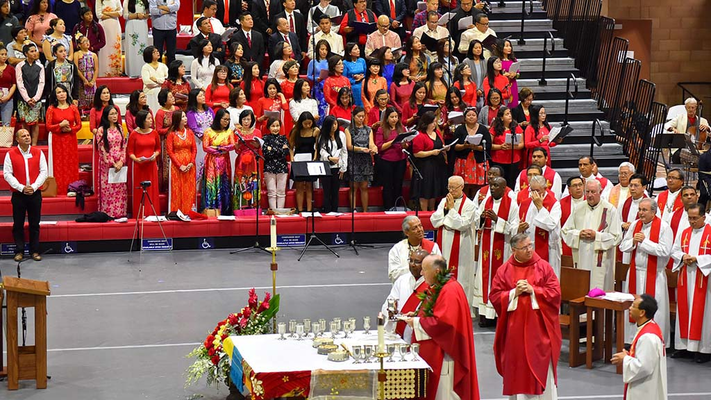 A Vietnamese choir sang during the multicultural Mass