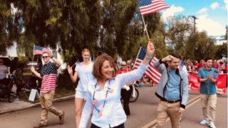 Susan Davis marches in a Memorial Day parade
