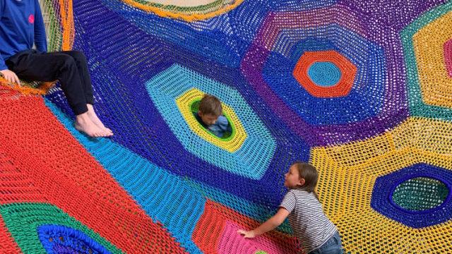"Children play on the ""Whammock!"" installation"
