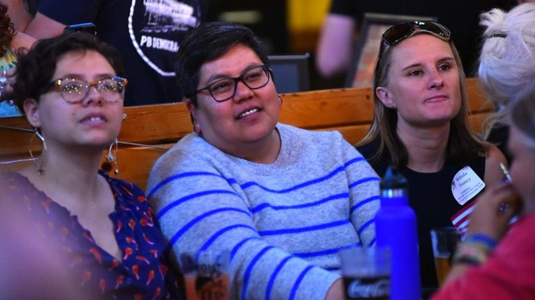 San Diego City Councilwoman Georgette Gómez (center) was among the attendees at the Pacific Beach Democratic Club debate watch party.
