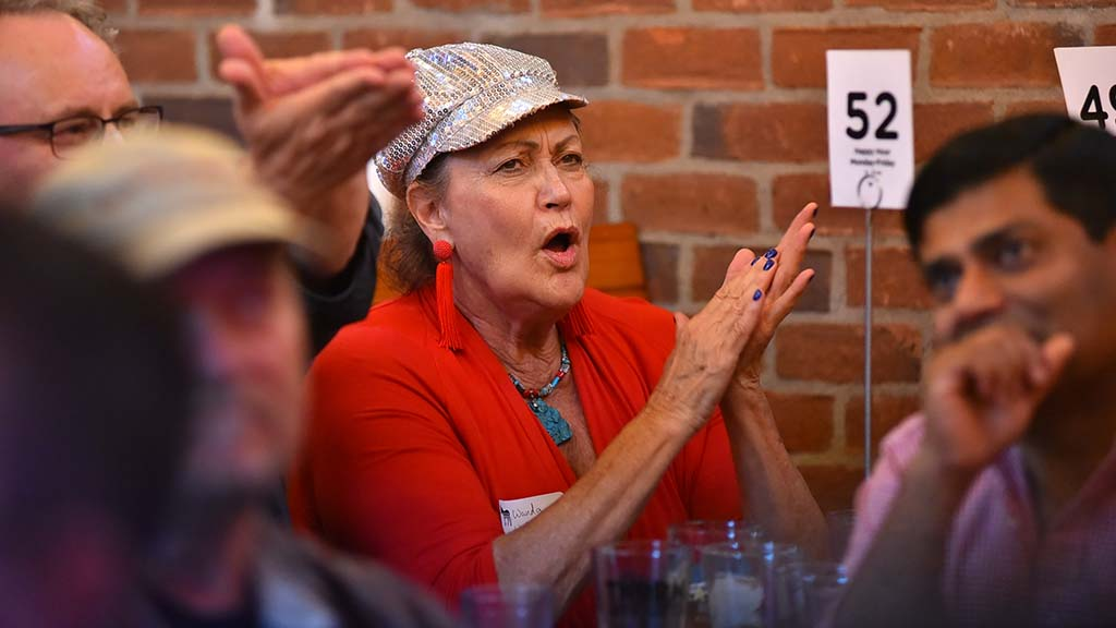 Wanda Wainman cheers a point made by a candidate at a Democratic debate watch party in Pacific Beach.