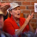 Wanda Wainman cheers a point at a Democratic debate watch party in Pacific Beach.