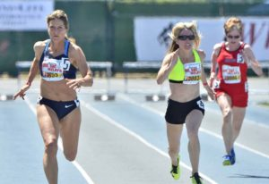"""Colleen Barney races Joy Upshaw (left) and Kathy Bergen (right) at 2016 Mt. SAC Relays. In 2018, Upshaw was among those urging Barney to apply for """"American Ninja Warrior."""""""