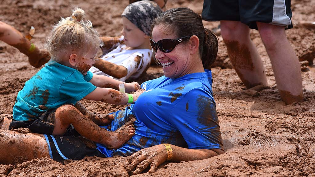 Johanna Asars of Temecula enjoys the mud pit with her two-year-old daughter, Emma.