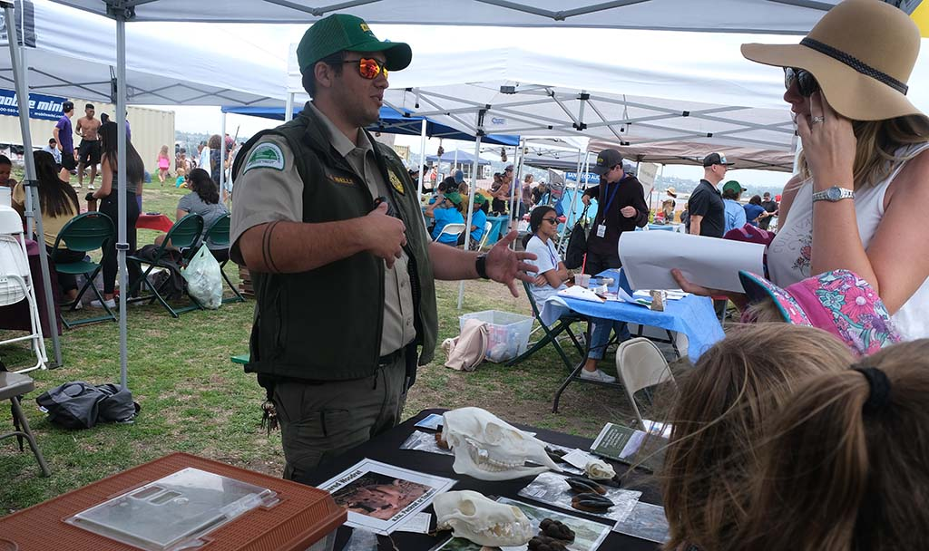 During the Mud Day event, Park Ranger James Ibelle explains about wildlife in the San Diego area.