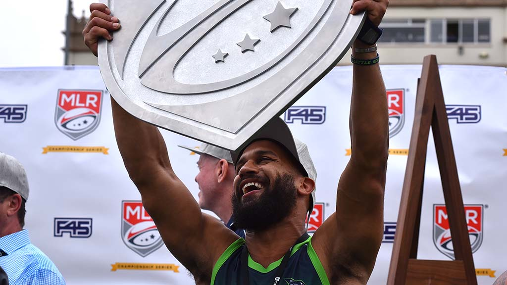 Seattle player holds shield trophy of Major League Rugby after Seawolves defended their 2018 title.