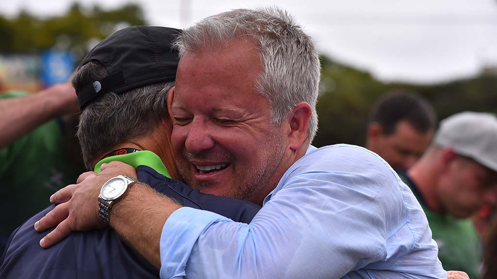 Seattle part owner Shane Skinner is hugged after 26-23 comeback victory in MLR title game.